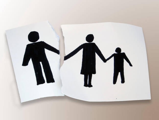 Paper image of a family torn apart, representing a family in which a protection order, or restraining order, has been put in place with the help of a divorce lawyer in the law offices of by Sharek Logan & van Leenen LLP, a top Edmonton law firm with family law lawyers.