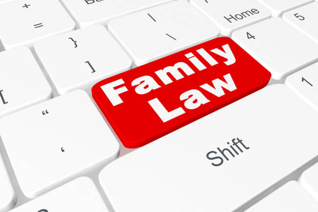 The words family law on computer keyboard, representing the search for a family law lawyer in Edmonton, best divorce lawyers in Edmonton or law firms offering help with spousal support, Alberta divorce law and legal separation.