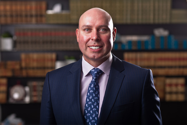 Edmonton lawyer Jonathan McCully of the law firm Sharek & Co, where he handles commercial, civic and insurance litigation, personal injury law suits and employment law.